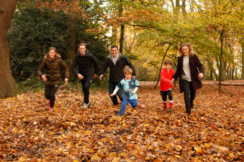 family running in the leaves